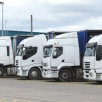 Row of HGV Drivers in White Lorries